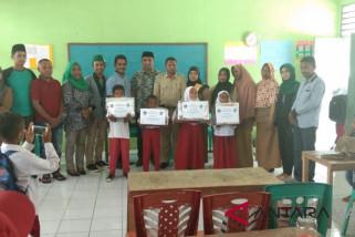 KAHMI-KOHATI Maluku Tenggara santuni siswa madrasah