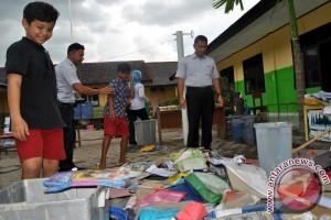 PT Timah Bantu Siswa Korban Banjir