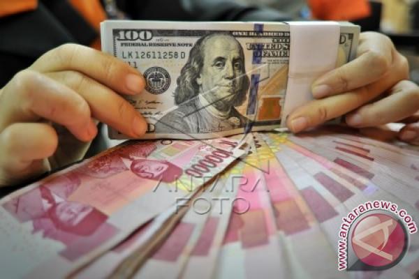 Rabu, Rupiah menguat jadi Rp13.572 per dolar AS