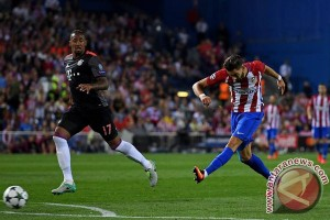 Gol Carrasco ke gawang Bayern antar Atletico ke puncak klasemen