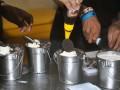 Peracik minuman menaburi biskuit dan coklat cair ke dalam minuman dari susu sapi di restoran Momo Milk, jalan KH. Abdullah Bin Nuh, Kota Bogor, Jawa Barat, Jum'at (16/12). Restoran yang menyajikan makanan dan minuman serba susu tersebut menggunakan ember mini alumunium sebagai tempat minum layaknya ember susu sapi untuk menarik perhatian pengunjung yang berwisata kuliner ke Kota Bogor. (ANTARA FOTO/Arif Firmansyah/16).