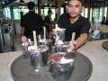 Peracik minuman selesai menyiapkan racikan minuman dari susu sapi di restoran Momo Milk, jalan KH. Abdullah Bin Nuh, Kota Bogor, Jawa Barat, Jum'at (16/12). Restoran yang menyajikan makanan dan minuman serba susu tersebut menggunakan ember mini alumunium sebagai tempat minum layaknya ember susu sapi untuk menarik perhatian pengunjung yang berwisata kuliner ke Kota Bogor. (ANTARA FOTO/Arif Firmansyah/16).
