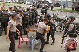 Penanganan Aksi Kerusuhan Pilkada Aceh