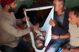 KPA Aceh Utara santuni bocah penderita tumor
