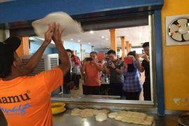 Atraksi roti canai terbang Penang