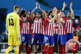 Atletico Madrid Bekuk Sevilla 2-0