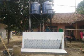 BUMN Hadir - Warga Manfaatkan Sarana Air Bersih Bantuan BUMN