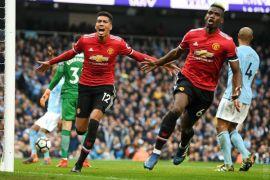 Dua gol Pogba tunda perayaan gelar Man City
