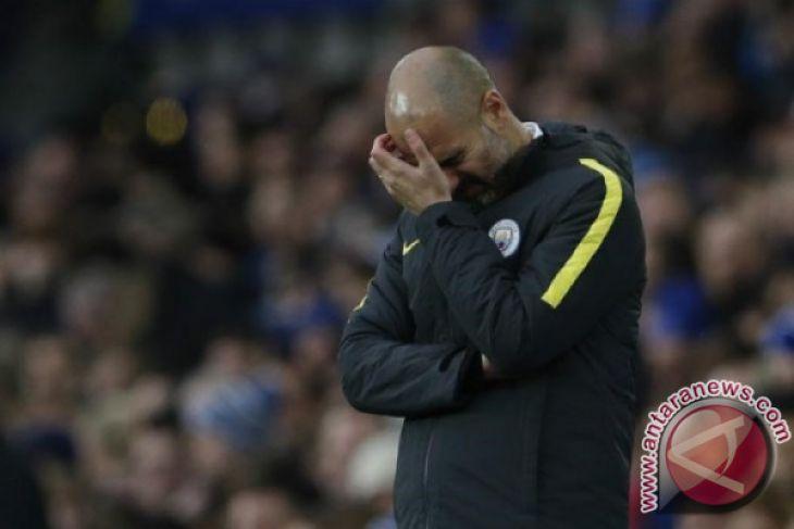Manchester United tertinggal 16 poin dari