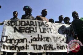 Pemberontak Papua yang beda ideologi dengan NKRI serahkan senjata ke TNI