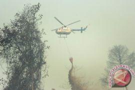 10 helikopter padamkan api di Kalbar