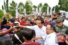 President: Exit farmers' garden from forest area