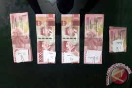 Two Balangan residents arrested carrying counterfeit money