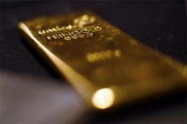 Emas turun ke tingkat terendah dalam enam bulan