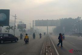 Thick smoke blankets Banjarbaru