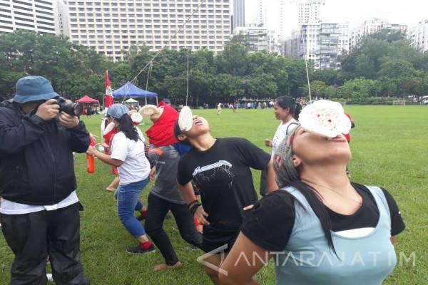 Hujan Tak Halangi Buruh Migran Indonesia Rayakan 17-an di Hong Kong (Video)