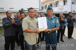 Pewarta Antara Jatim Juara Lomba Foto HUT TNI