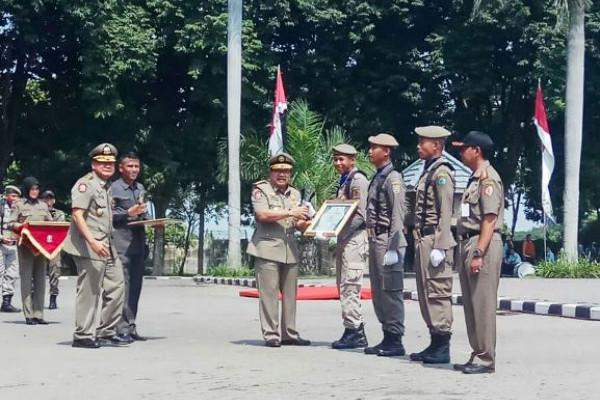 Satpol PP Kabupaten Madiun Juarai Lomba Defile Jatim