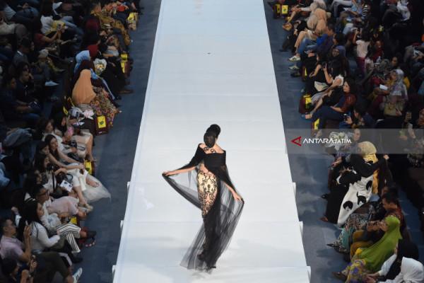 Perancang Busana dan Pemilik Rumah Mode