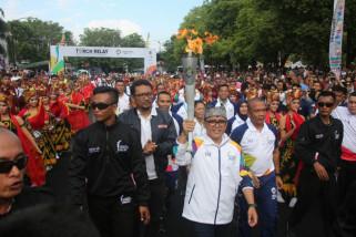 Atraksi Kesenian dan Ribuan Warga Banyuwangi Sambut Pawai Obor Asian Games 2018