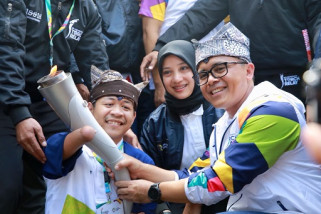 Fotografes Difabel Ikut Bawa Obor Asian Games