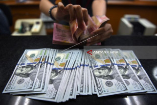 Dolar AS Menguat karena Turbulensi Politik Rongrong Poundsterling