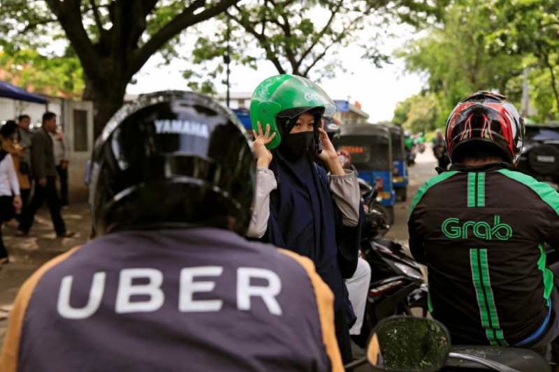 Grab dan Uber didenda karena lakukan merger