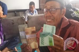BI Bagi-bagi Alat Pemeriksa Uang Palsu