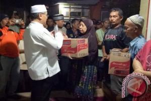Bupati HSS Bantu Korban Kebakaran Gang Gembira
