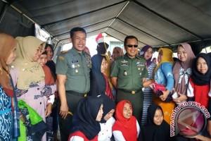 KEGIATAN TNI MANUNGGAL MEMBANGUN DESA