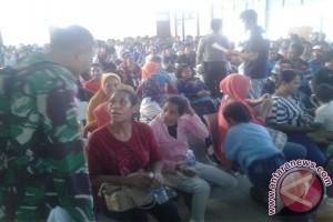 Satgas Perbatasan Beri Pengamanan 205 TKI Yang Dideportasi