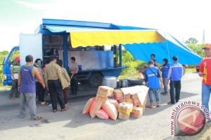 Kaltim Bantu 52 Ton Beras Korban Banjir