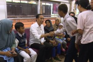Presiden Jokowi Naik Commuter Line Rayakan HUT KAI
